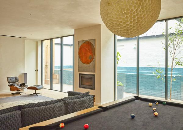 The house features a pool table and a cinema room, to keep both the adults and children connected.