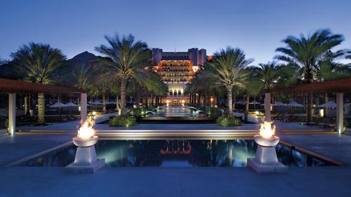 Al Bustan Palace is flanked by the rock cliffs of the Haijar Mountains / Al Bustan Palace