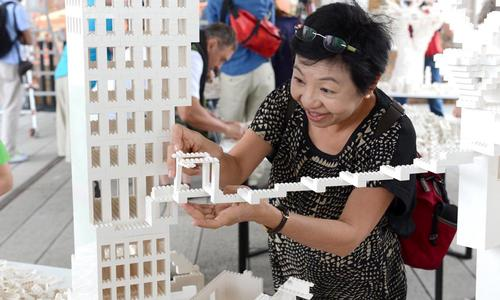 One happy visitor helps create a bridge between two of the architects' structures / Timothy Schenck