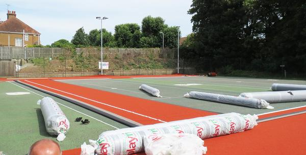 The new artificial surface performs just like real clay but has a lower maintenance cost