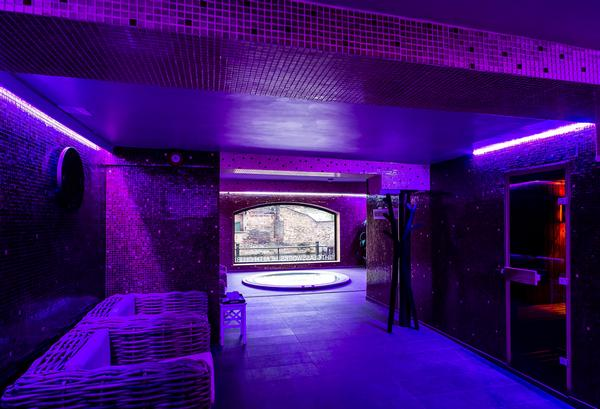 Low lighting and dark tones feature in the spa