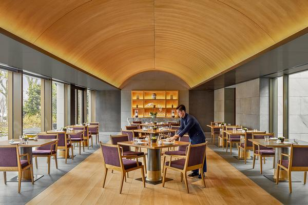 Amanyangyun's main restaurant, Lazhu, is light-filled and airy, overlooking a bamboo grove
