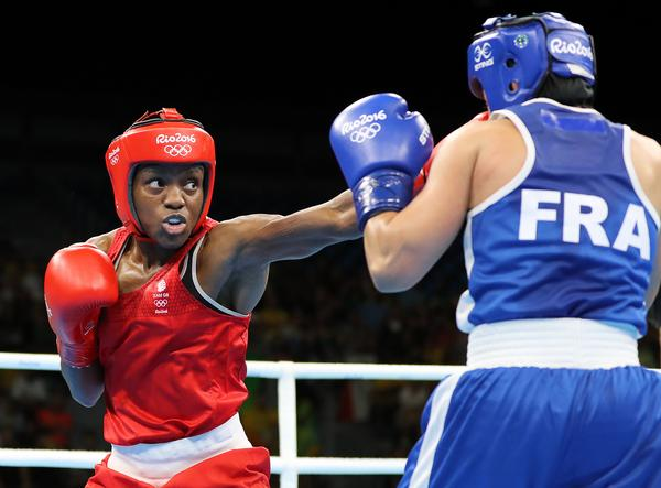 GB Gold medallist Nicola Adams in action against France's Sarah Ourahmoune. The average GB medal cost for boxing was £4.5m / owen humphreys / press association