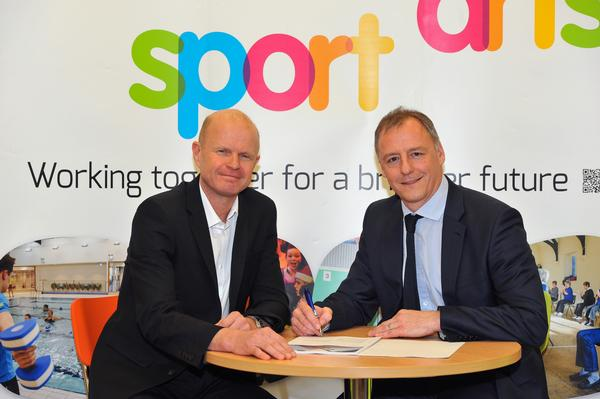 MK Council's Paul Sanders (left) and 1Life MD Neil King sign the MK leisure contract.