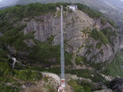 A 180-metre-deep chasm sits below the glass suspension bridge  /  Haim Dotan