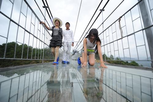 Visitors see a clear 180m drop below the bridge /  Haim Dotan
