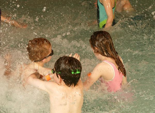 Swimming is a fun, family activity that can help autistic children with social skills