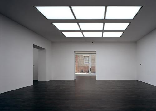 The 1,600sq m (17,200sq ft) gallery is centrally lit, with dark oak wood floors for contrast
