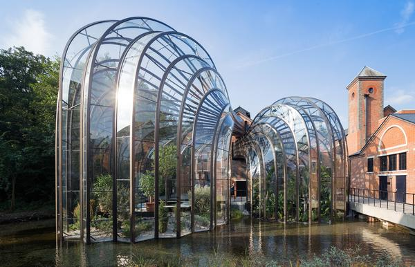 The intertwining botanical glasshouses are made from 893 individually shaped curved glass pieces