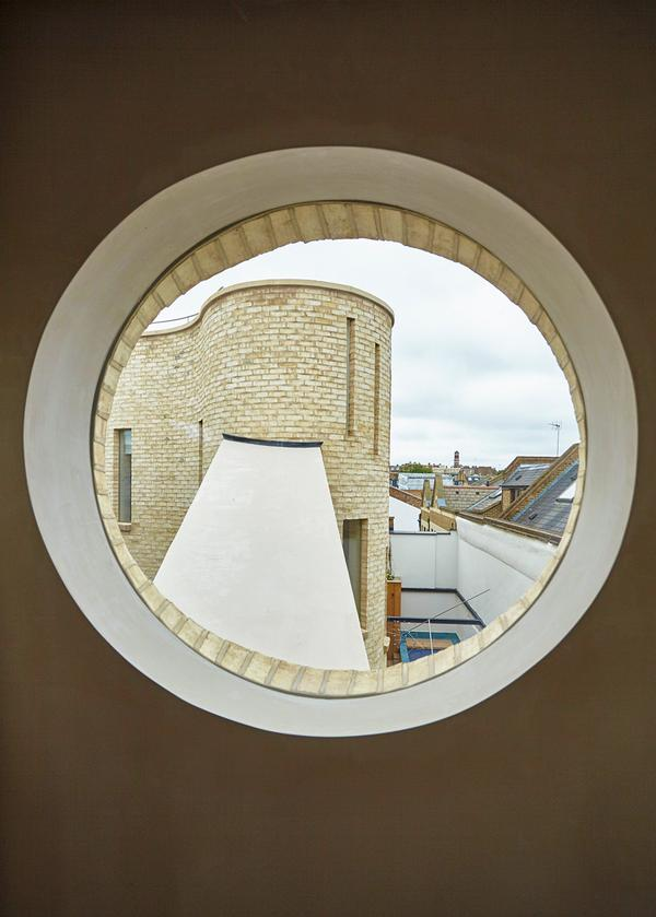 The home also features two curved towers, which house the bedrooms and a play area for the children