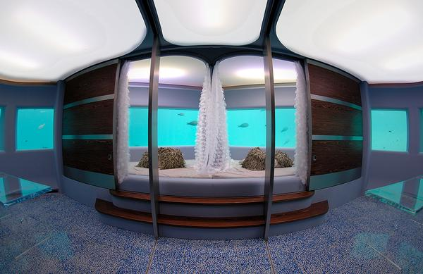 The underwater spa treatment rooms feature large windows looking out into the water