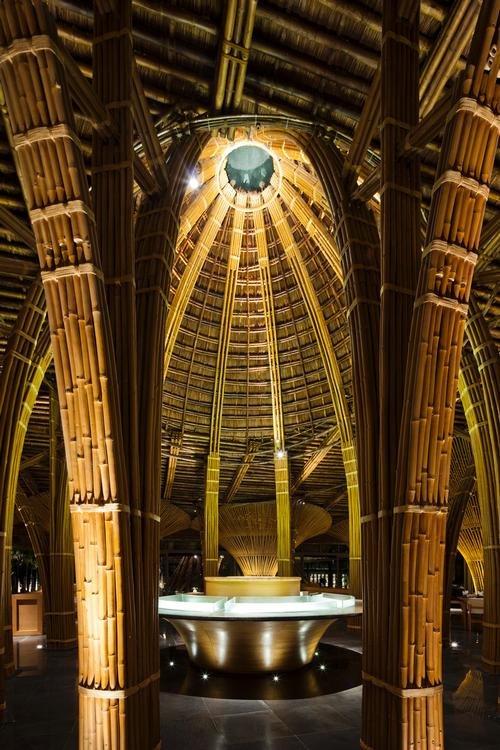 Skylights built into the bamboo domes allow daylight to enter the restaurant / Vo Trong Nghia Architects