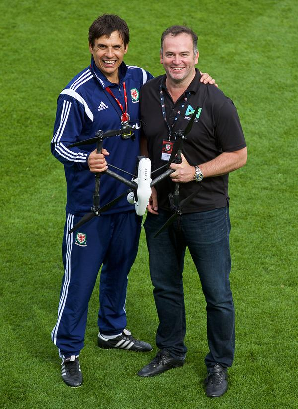 Brandon Lee (right) of US-based Arch Aerial with football manager Chris Coleman (left) / sergei grits / press association