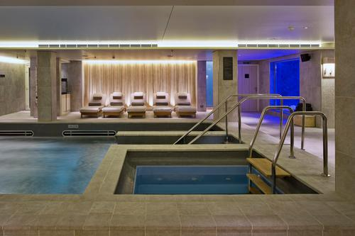 Day beds and heated ceramic loungers line the outside of the wet zone / Raison d'Etre