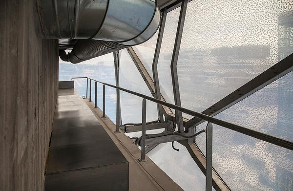 The design features industrial-looking surfaces and exposed pipework