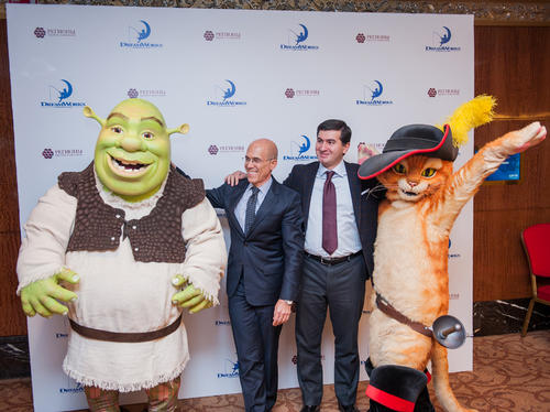 DreamWorks Animation chief executive Jeffrey Katzenberg and Amiran Mutsoev of REGIONS GC pose with Shrek and Puss in Boots at the press conference announcing three new DreamWorks theme parks in Russia