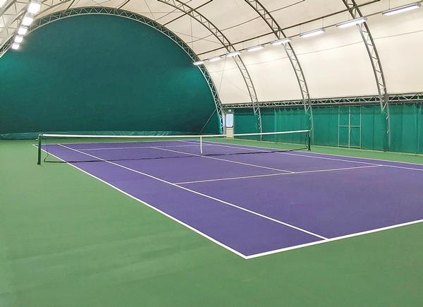 The two courts are covered by a framed fabric structure