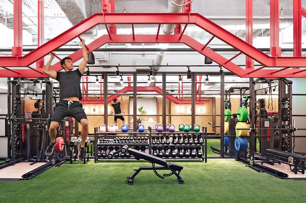 WeWork's head of interiors Brittney Hart set out to create a playful gym experience. Fake grass adds interest to the workout space / Rise photo: Kris Tamburello