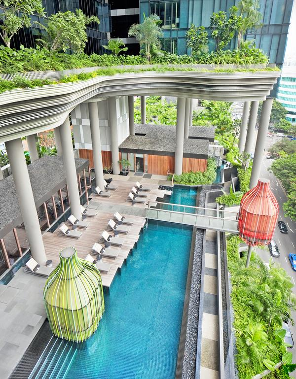 The pool at Parkroyal on Pickering is set amongst lush plantlife, which can be explored via a network of pathways