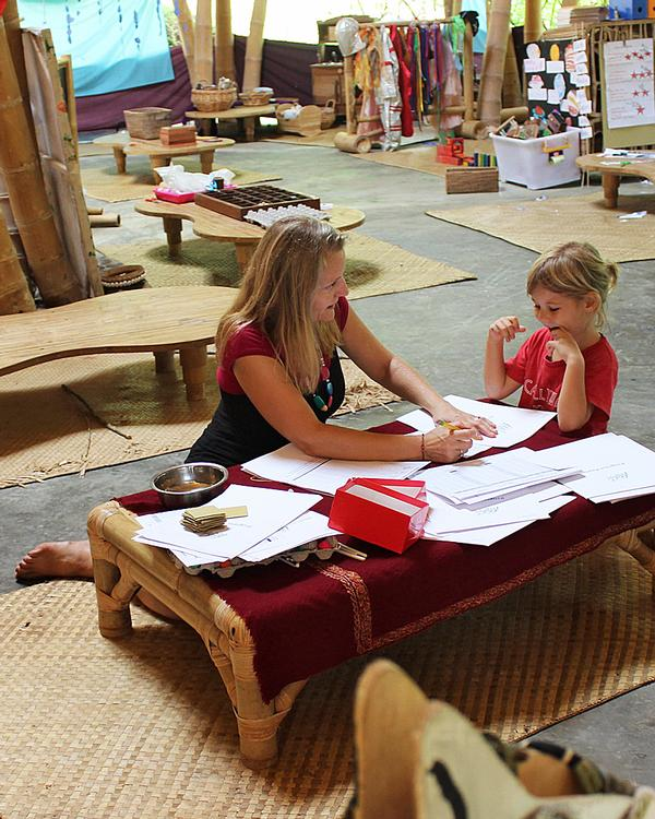 Children learn in open sided, bamboo classrooms