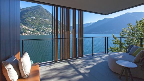 Each of the 30 guest rooms has its own terrace with views of Lake Como. Urquiola designed furniture, lamps, wall coverings and rugs for the bedrooms and public spaces