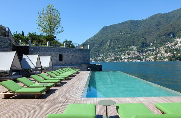 An infinity pool looks out across the lake, Italian Alps and small towns and the hotel also has a private beach.