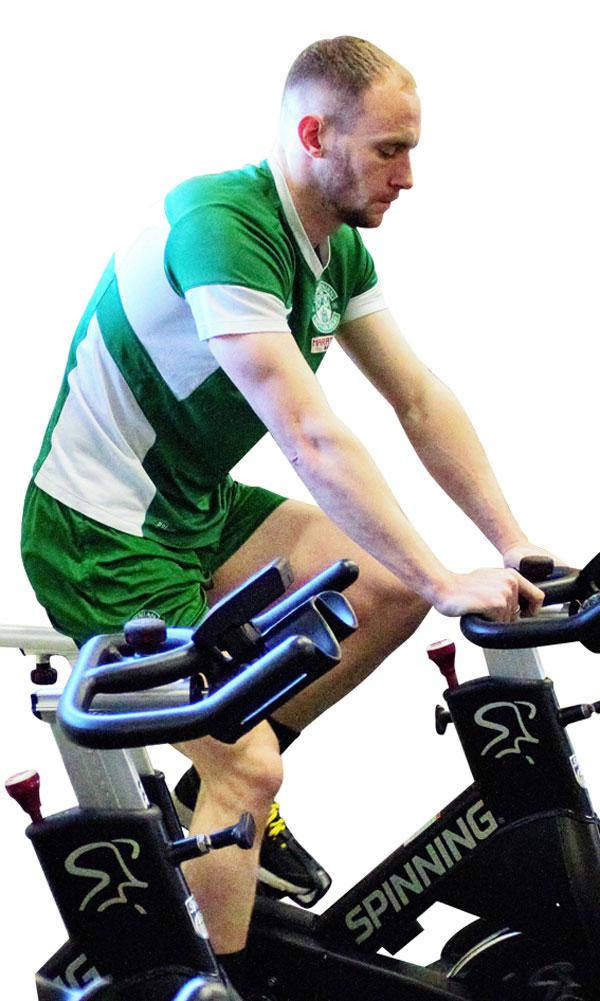 Hibernian FC players do active recovery sessions on Origin bikes