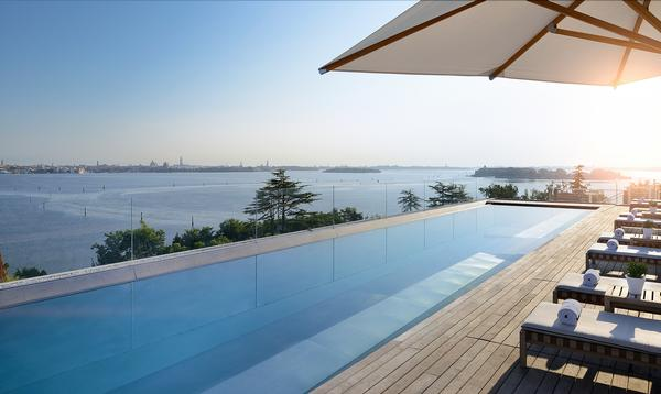 The outdoor pool deck offers views across to Venice