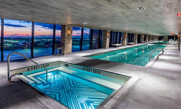 The glass skybridge that links the towers houses an indoor pool and hot tub, as well as 