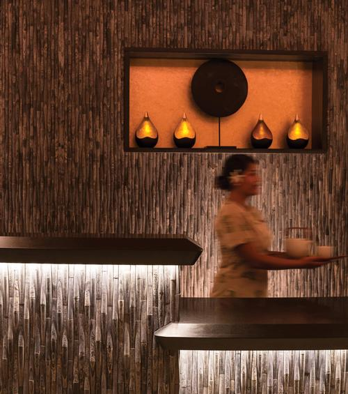 The 11-treatment room spa features a clean, contemporary design, incorporating natural wood found throughout the islands and a slate reception desk
