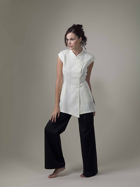 The popular sleeveless yin top has a mao style collar and for Spa uniform france