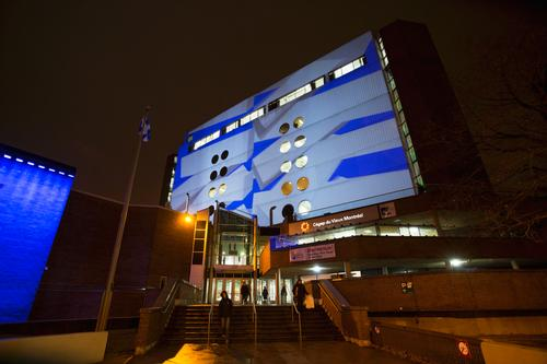 Abstract video projections are displayed on the walls of nine surrounding buildings / Ulysse Lemerise