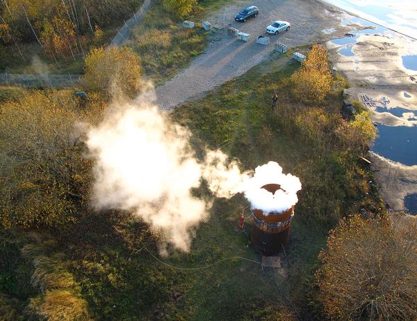 The generator sends a symbolic ring of steam into the sky every time the power plant emits a ton of CO2