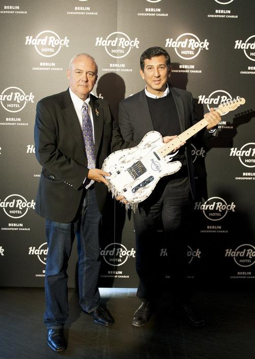 Hard Rock International CEO Hamish Dodds presents a custom guitar to Heskel Nathaniel, founder of Trockland Development Group / Trockland