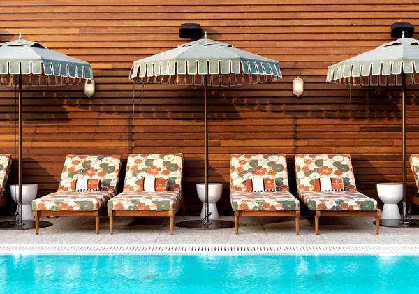 Guests and members can enjoy lunch and  cocktails by the pool at Soho House White City