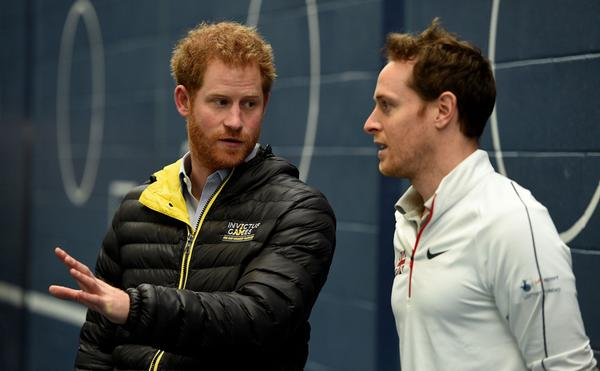 Prince Harry with Cain Berry, performance support manager for the Tennis Foundation