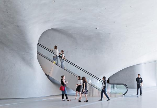 Visitors enter the north or south side of the building, taking a long escalator to the gallery / PHOTOS: Iwan Baan