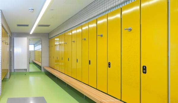 Changing rooms feature Corian tiles, solid beech seating and bright colours