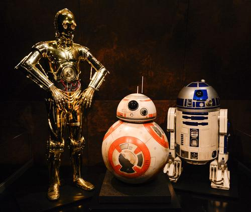 Many iconic costumes are on display, including C3P0, BB-8 and R2D2 / Discovery Times Square