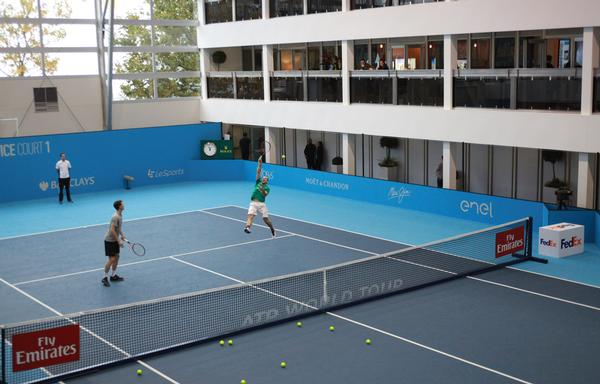 The two temporary structures are separated by a practice court