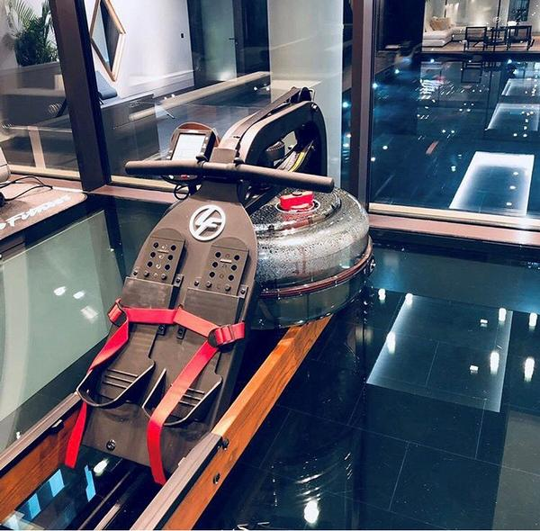 A water resistance rower, on a glass floor, over water – the closest you'll get to the real thing