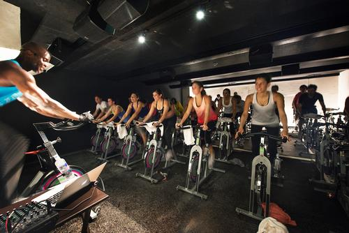 """Síclo's two main cycling studios are stacked underneath the stairway, """"integrating physical, emotional and spiritual fitness and wellbeing"""" within the complex / Jaime Navarro Soto"""