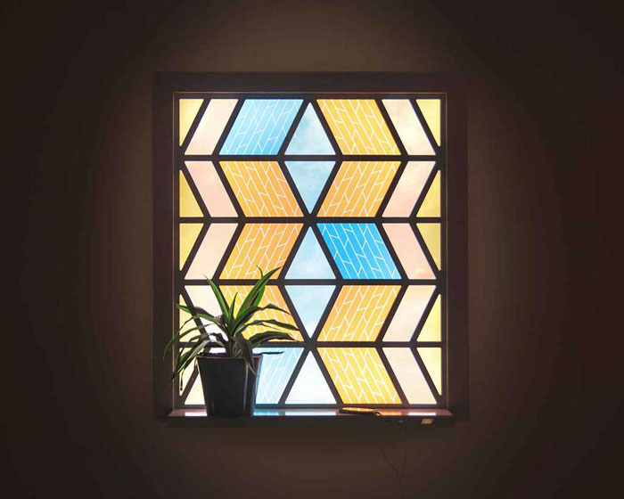 A stained glass window that's also a solar panel