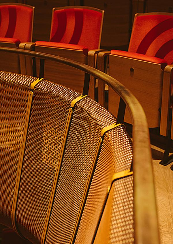 A bronze mesh allows sound energy to reach the hall's walls, improving the acoustics