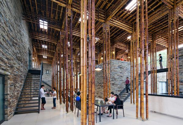 Son La Restaurant in Son La, Vietnam, is a low-cost structure by Vo Trong Nghia Architects that uses bamboo and stone