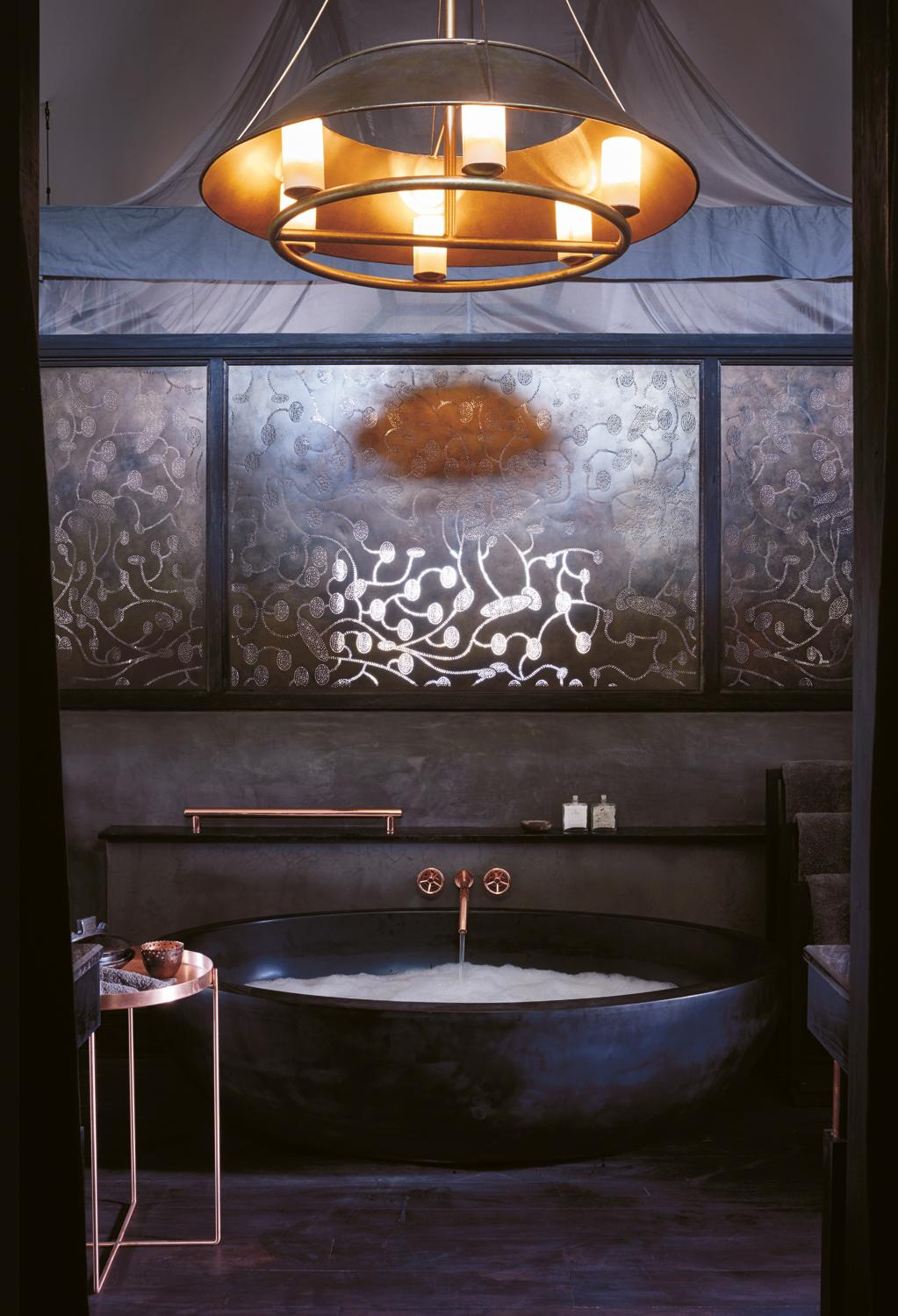 Guest rooms feature copper, referencing Botswana's copper mining industry / Belmond Eagle Island Lodge Botswana