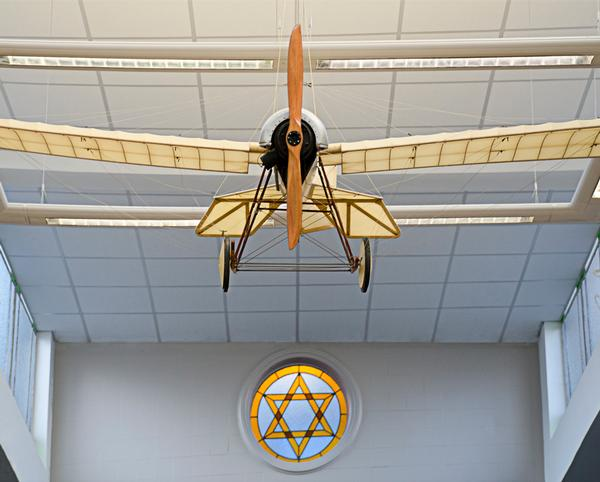 A model aeroplane hangs from the ceiling