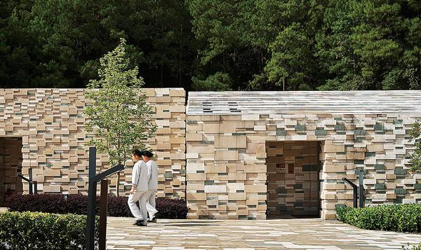 Locally quarried stone was used to evoke the landscape in China's Yunnan province