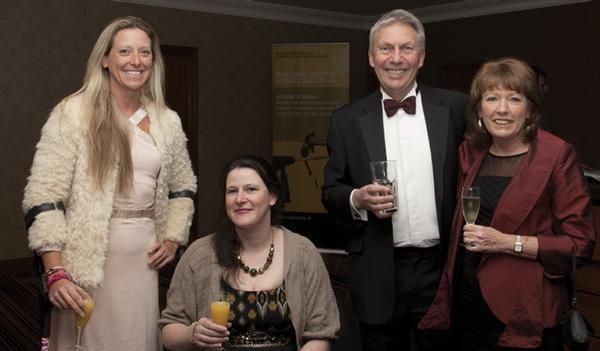 Wheelchair racers Mel Nicholls and Jen Warren with David and Linda Moorcroft