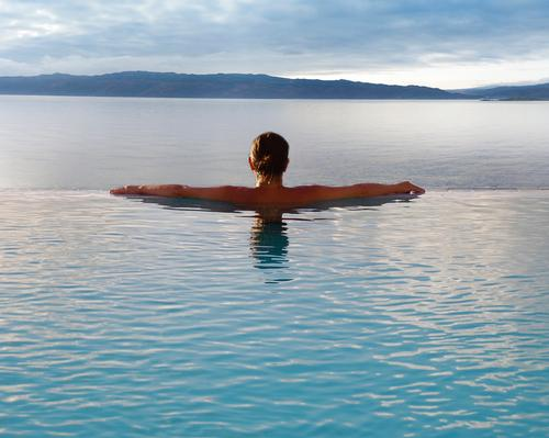 The infinity pool looks out over Loch Fyne to the Isle of Arran / Portavadie